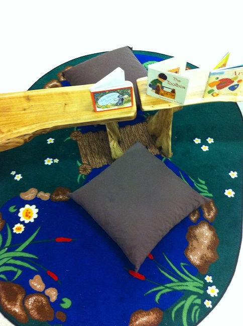 Pond mat with fabric cushions and wooden benches.